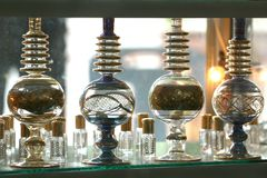 Aroma Therapy. Crystal flasks and varieties of perfumes displayed on counter stock photo