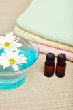 Aroma Therapy. With iols and flowers Royalty Free Stock Photography