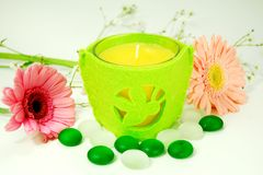Aroma Therapy Candle. Candle and  therapy stones setting with flowers for aroma therapy Royalty Free Stock Photos