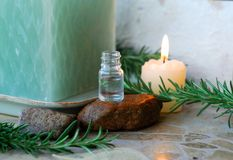 Aroma therapy oil. Bottle of essential oil, massage stones,candles,lavender Royalty Free Stock Photo