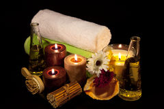 Aroma Therapy Series 12. Essential Oil Bottles, towels, candle and flower for healthy spa treatment Royalty Free Stock Photos