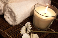 Aroma Therapy Series 5. Essential Oil Bottles, towels, candle and flower for healthy spa treatment Royalty Free Stock Photography