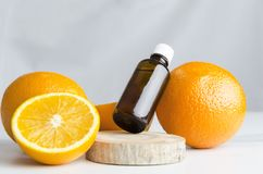 Aroma therapy at spa salon.Oranges and orange oil for healthcare on wooden board,marble table against grey wall stock photos