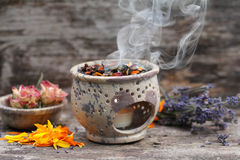 Aroma therapy. Spiritual smoking with native herbs stock images