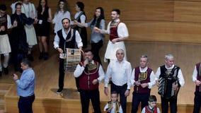 Aromanian artists at Primuveara Armanjilor, annual event. Aromanian artists singing at musical event in Bucharest 2018. Gica Coada, Hrista Lupci folk music