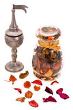 Aromas. Aromatic dry herbs and container for aroma Royalty Free Stock Images