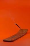 Aromas. Smoking east aromas on an orange background Stock Image