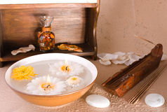 Aromas therapy. Aromatherapy elements with candles in water, incense ans oils Royalty Free Stock Photo