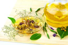 Aromatherapie with green leaves Stock Photo