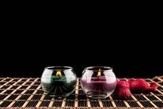 Aromatherapy κεριά SPA σε ένα μαύρο υπόβαθρο Στοκ Φωτογραφία