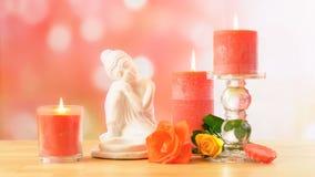 Aromatherapy πίνακας SPA ύφους της Zen που θέτει με το Βούδα, τα λουλούδια και τα κεριά Στοκ Φωτογραφίες