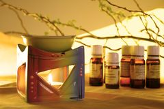 Aromatherapy. Aroma Lamp with Burning Candle and Bottles with Oil Aromatherapy Royalty Free Stock Images