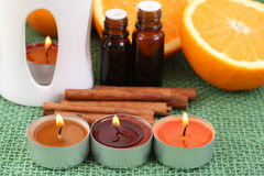 Aromatherapy. Perfect for winter time - candles and oranges Stock Images
