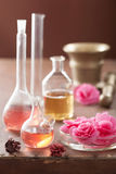 Aromatherapy and alchemy with pink flowers Royalty Free Stock Photos