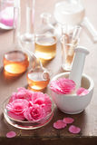 Aromatherapy and alchemy with pink flowers Royalty Free Stock Image