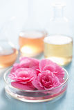 Aromatherapy and alchemy with pink flowers. Aromatherapy and alchemy with pink begonia flowers Stock Photos