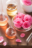 Aromatherapy and alchemy with pink flowers Royalty Free Stock Photo