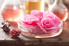 Aromatherapy and alchemy with pink flowers. Aromatherapy and alchemy with pink begonia flowers Stock Photography
