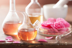 Aromatherapy and alchemy with pink flowers Royalty Free Stock Images