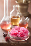 Aromatherapy and alchemy with pink flowers Stock Images