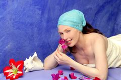 Aromatherapy on a blue board pink flowers Royalty Free Stock Image