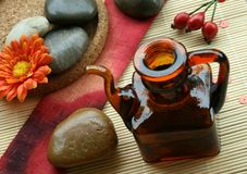 Aromatherapy, bottle with oil. And stones Stock Photography