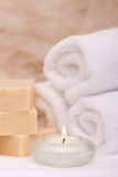 Aromatherapy candle, bath towels and soap Stock Images