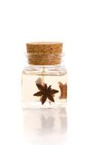 Aromatherapy candle in glass bottle with corkwood. Stopper isolated on white with reflection Stock Image