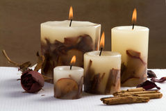 Aromatherapy candlelight. A candlelight with cinnamon, apple and rose aroma Royalty Free Stock Photography