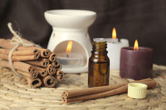 Aromatherapy - candles and cinnamon. Aromatherapy and spa - candles and cinnamon Royalty Free Stock Images