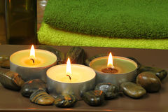 Aromatherapy candles and massage stones in spa Stock Photo