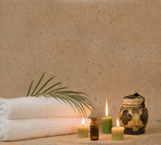 Aromatherapy candles and oil. With bath towels at spa Royalty Free Stock Photography