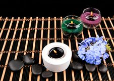 Aromatherapy. Candles and spa objects on black background.  Stock Photography