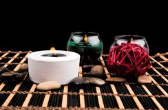 Aromatherapy. Candles and spa objects on black background.  Royalty Free Stock Photo