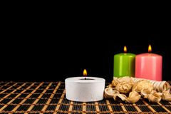 Aromatherapy. Candles and spa objects on black background.  Stock Photo