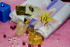 Aromatherapy Concept. Massage oil,fresh flower,massage oil and spa concept Stock Photography
