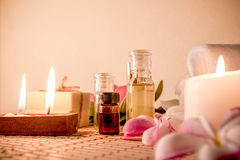 Aromatherapy essential oil, natural soap and lilac flower Stock Images