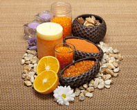 Aromatherapy - Flowers and orange bath salt Royalty Free Stock Photos