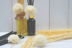 Aromatic essence oil bottle with bottle of fragrance reeds diffuser Royalty Free Stock Photos