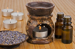 Aromatherapy. Lamp with oils and dried lavender royalty free stock photo