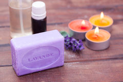 Aromatherapy. Lavender soap candles and essential oils Royalty Free Stock Photography