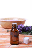 Aromatherapy oil. Against bathsalt and lavander flower Stock Photography