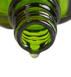 Aromatherapy oil bottle and drop of oil Stock Images