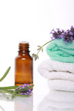 Aromatherapy oil and lavender. Aromatherapy oil, lavender and towels Royalty Free Stock Image
