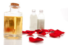 Aromatherapy oils and body lotions. On white background Stock Photos
