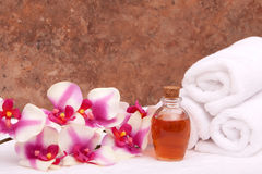 Aromatherapy oils, orchid and towels Stock Photos