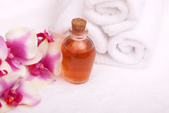 Aromatherapy oils, orchid and towels Royalty Free Stock Photos