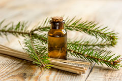 Aromatherapy with organic spruce oils in glass bottles on wooden table background Royalty Free Stock Image