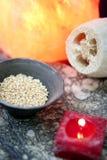 Aromatherapy, red candle, sea marine sponge Royalty Free Stock Photos