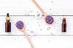 Aromatherapy for relax concept. Lavender branch, spa salt, oil and candles on white background top view Stock Images